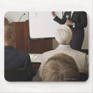 Woman teaching a class to adults mouse pad