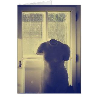 Woman torso sculpture by the window card