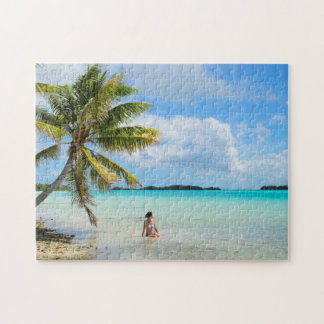 Woman under a palm tree in the Pacific puzzle