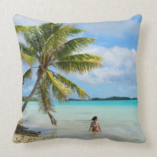Woman under a palm tree throw pillow