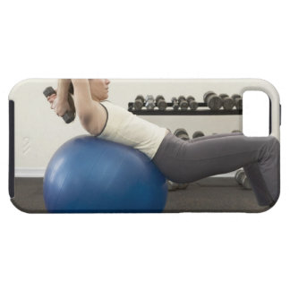 Woman using exercise ball and hand weights iPhone 5 cases
