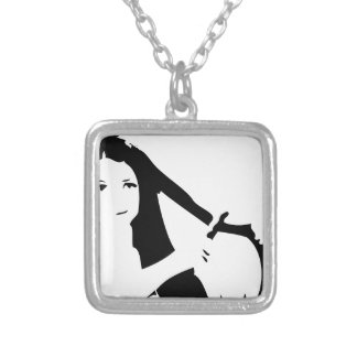 Woman using flat iron on hair silver plated necklace