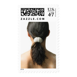 Woman using sea urchin as pony tail holder postage stamp