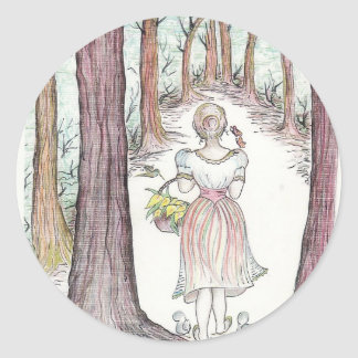 Woman walking along a wooded path. classic round sticker