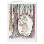 Woman walking along a wooded path. greeting card