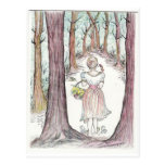 Woman walking along a wooded path. post cards
