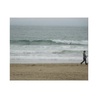 Woman Walking Dog Along Pismo Beach, CA Stretched Canvas Prints