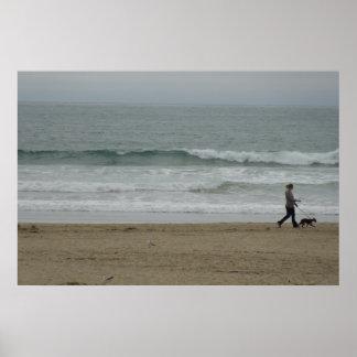 Woman Walking Dog Along Pismo Beach, CA Poster