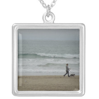 Woman Walking Dog Along Pismo Beach, CA Silver Plated Necklace