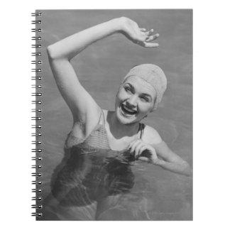 Woman Waving Notebooks