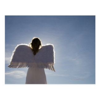 Woman wearing angel wings, rear view, three postcard