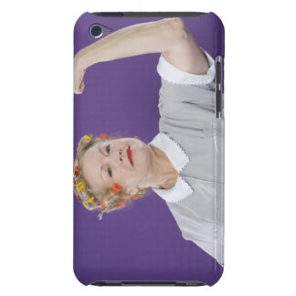 Woman wearing hair curlers, tensing arm muscles, barely there iPod case