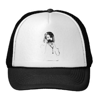 woman with a camera trucker hat