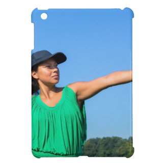 Woman with glove and cap throwing baseball outside cover for the iPad mini