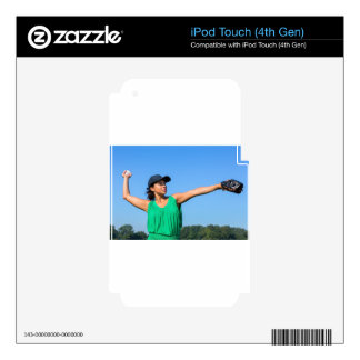 Woman with glove and cap throwing baseball outside skins for iPod touch 4G