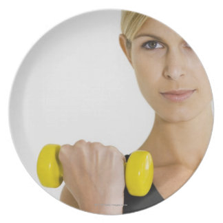Woman with hand weight plates