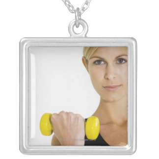 Woman with hand weight square pendant necklace