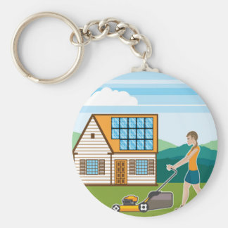 Woman with lawnmower at her house keychain