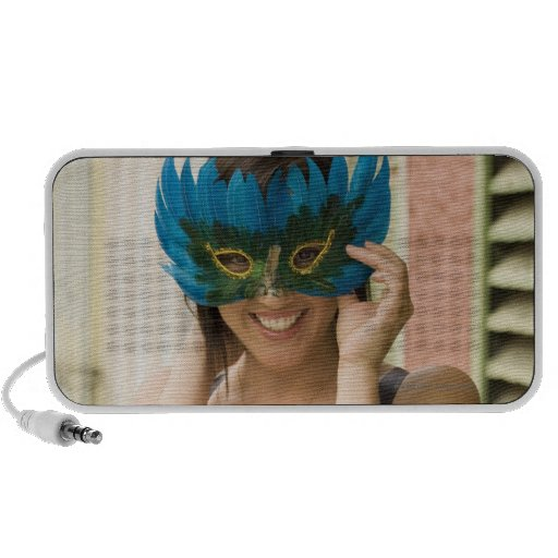 Woman with masquerade mask mini speaker