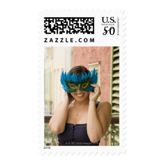 Woman with masquerade mask postage