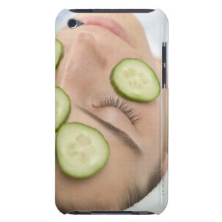 Woman with slices of fresh cucumber on her face, iPod touch cases