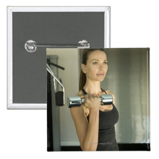 Woman working out in a gym 2 button