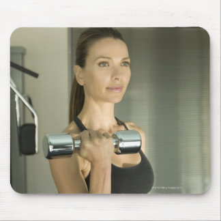 Woman working out in a gym 2 mouse pad