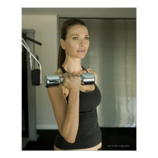 Woman working out in a gym 2 poster