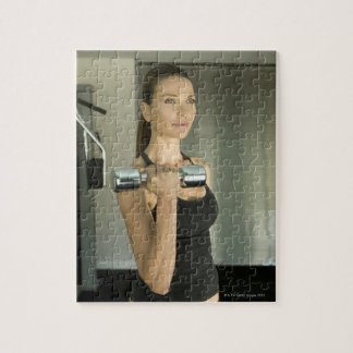 Woman working out in a gym 2 puzzle