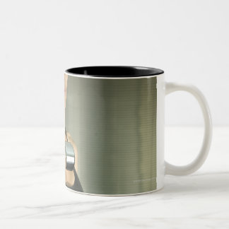 Woman working out in a gym 2 Two-Tone coffee mug
