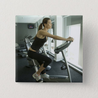 Woman working out in a gym 3 button
