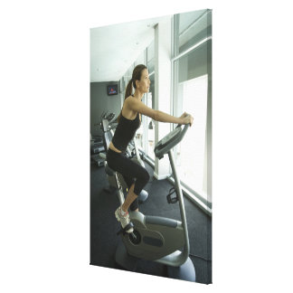 Woman working out in a gym 3 stretched canvas print