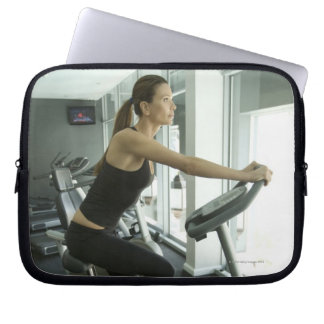 Woman working out in a gym 3 computer sleeve