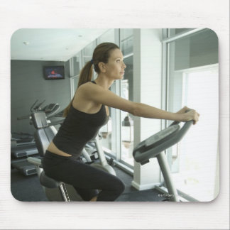 Woman working out in a gym 3 mousepads