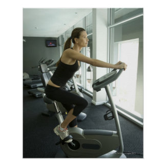 Woman working out in a gym 3 poster