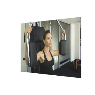 Woman working out in a gym canvas print
