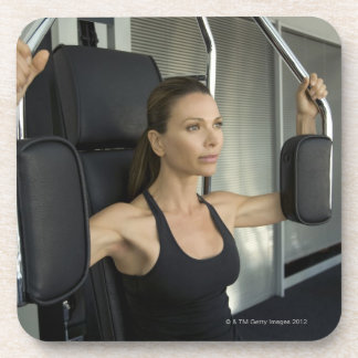Woman working out in a gym coasters