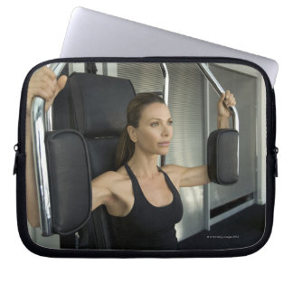 Woman working out in a gym laptop sleeves
