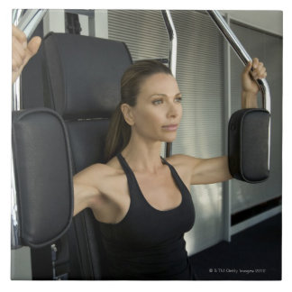 Woman working out in a gym large square tile
