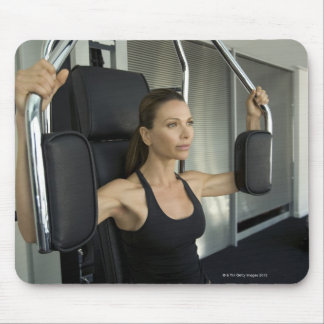 Woman working out in a gym mouse pad