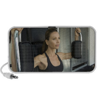 Woman working out in a gym speaker system