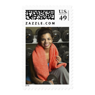 Woman working out postage stamp