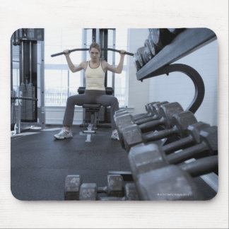 Woman working out with weights 2 mouse pad