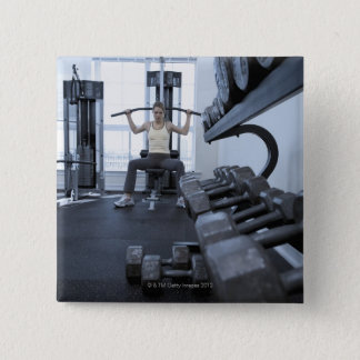 Woman working out with weights 2 pinback button
