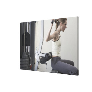 Woman working out with weights canvas print