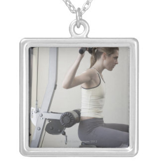 Woman working out with weights personalized necklace