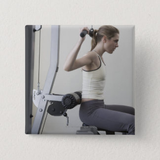 Woman working out with weights pinback button