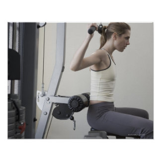 Woman working out with weights poster