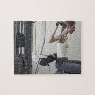 Woman working out with weights puzzle