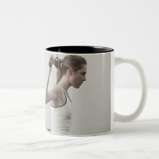 Woman working out with weights Two-Tone coffee mug